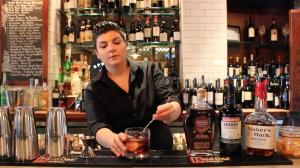 Cocktail making cherry manhattan